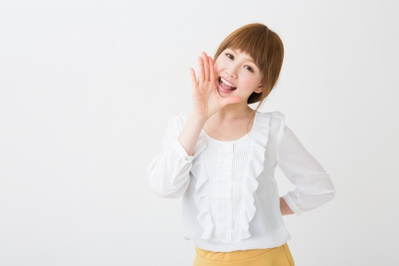 The young businesswoman who is cheering 版權商用圖片