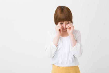young attractive asian woman who cries Foto de archivo