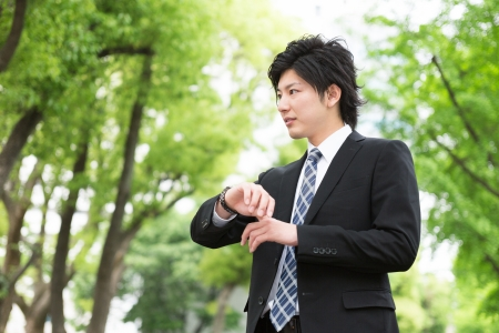 young businessman to see a watch