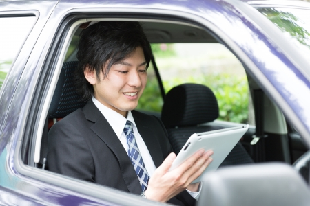 young businessman in a car