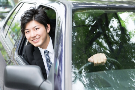 asian trees: young businessman in a car