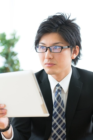 young businessman using tablet computer photo