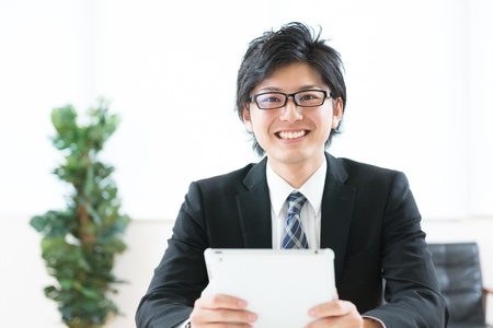 young businessman using tablet computer