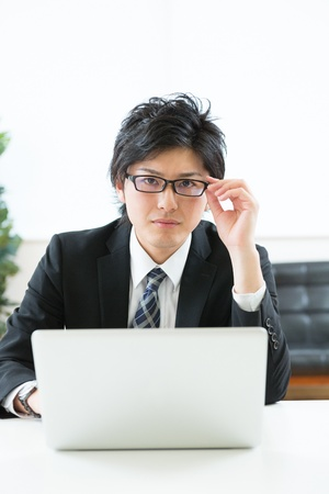 young businessman using computer Stock Photo