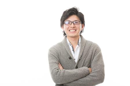 aantrekkelijke jonge Aziatische man van de glimlach Stockfoto