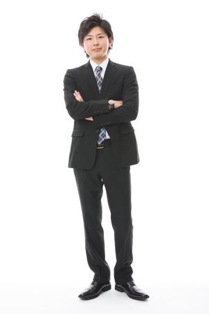 Junger Geschäftsmann mit dem Vertrauen