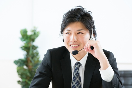 young man customer service operator