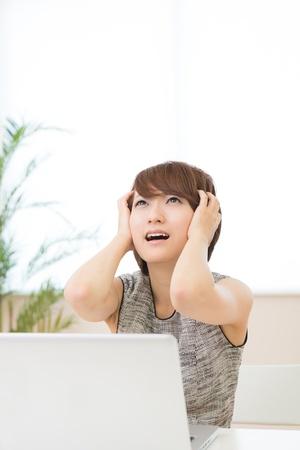 Beautiful young asian woman using laptop Stock Photo - 21043222