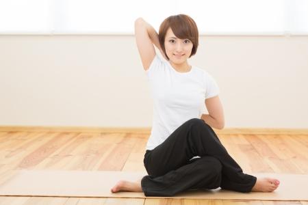 Beautiful young asian woman do yoga indoors