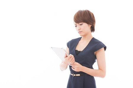 perplex: Beautiful young asian woman using tablet computer Stock Photo