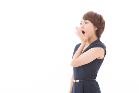 Beautiful young asian woman who yawns