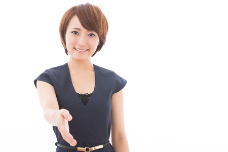 Beautiful young asian woman who shakes hands Imagens
