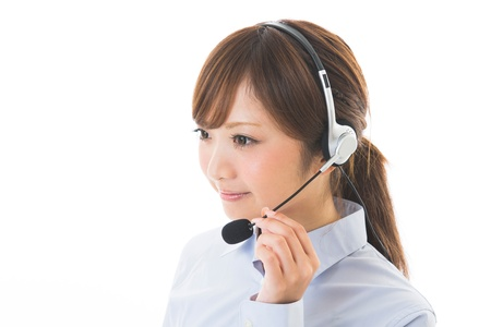 young attractive asian woman who works as an operator Foto de archivo