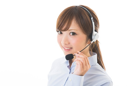 young attractive asian woman who works as an operator Stock Photo