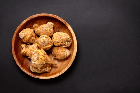 Maca in a wooden plate Stock Photo