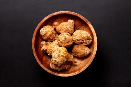 Maca in a wooden plate 写真素材