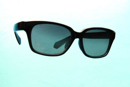 Black edge sunglasses floating in the air Image of summer