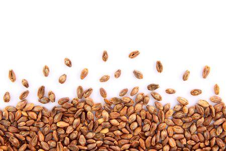 Super barley grains scattered on a white background.
