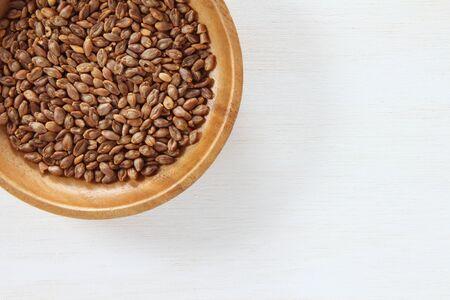 Super barley on a wooden dish.