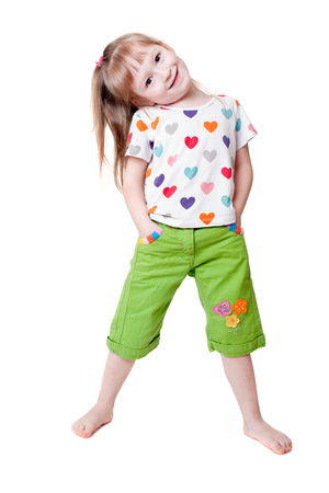 little colours: The pretty little girl in a T-shirt with hearts
