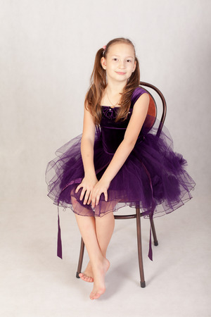 girl sitting: girl in a beautiful dress sits on a chair Stock Photo