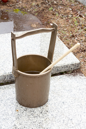 baptize: Japanese religous bucket and radle to  baptize in the grave