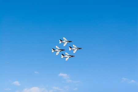 impulse: SAITAMA, JAPAN - NOVEMBER 3, 2014: Japanese Air Self-Defense Force holds their annual airshow at their Iruma airbase. They have a demonstration flight by an aerobatic team called Blue Impulse.