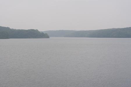 somber: A misty somber lake landscape Stock Photo