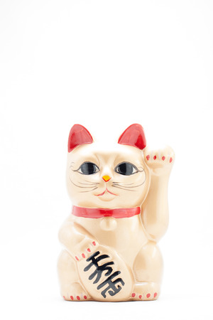 beckoning: Japanese golden beckoning cat called Manekineko also known as a lucky cat Stock Photo