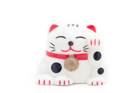 beckoning: Japanese beckoning cat called Manekineko on white isolated background
