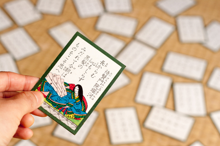A Japanese traditional card game called Hyakunin Isshu, holding a card by a hand Stock Photo