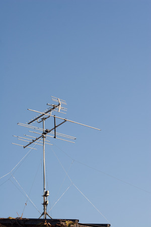 digital television: Digital television antenna on blue sky background