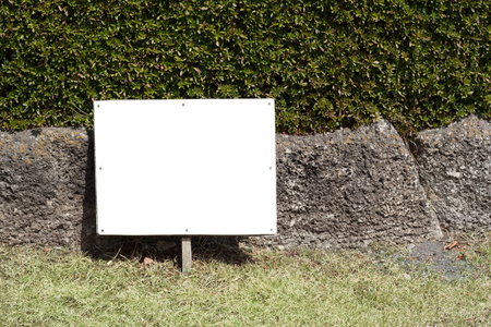 yard sign: Empty white sign board frame in the lawn yard