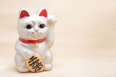 Japanese silver beckoning cat called Manekineko also known as a lucky cat