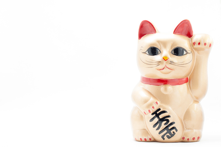 maneki: Japanese golden beckoning cat called Manekineko also known as a lucky cat Stock Photo