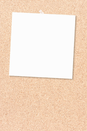 pin board: Cork board as a white piece of paper  thumbtacked Stock Photo