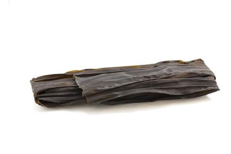 Japnaese dried seawead called Konbu or Kombu on white isolated background