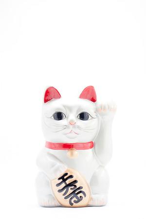 beckoning: Japanese silver beckoning cat called Manekineko also known as a lucky cat