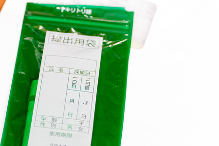 constipated: Container of feces examination in Japan Stock Photo