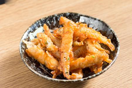 Japanese cuisine, fried small fish called wakasagi on the table