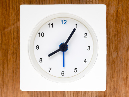 continuation: The second series of the sequence of time on the simple white analog clock , 6596 Stock Photo