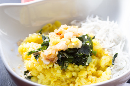 Japanese cuisine, sauteed green onion and rice with some seaweeds