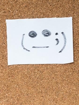 awkward: The series of Japanese emoticons called Kaomoji on the cork board, awkward
