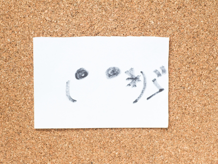 bashful: The series of Japanese emoticons called Kaomoji on the cork board, embarrassed Stock Photo
