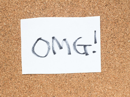 The series of a message on a piece of paper on the cork board, OMG Stock Photo