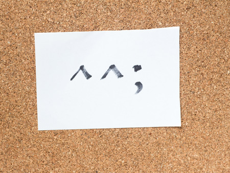 awkward: The series of Japanese emoticons called Kaomoji on the cork board, awkward