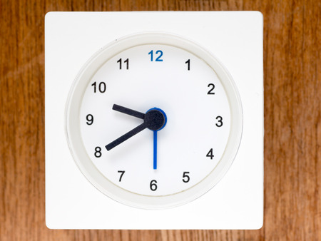 just in time: The second series of the sequence of time on the simple white analog clock , 7896 Stock Photo