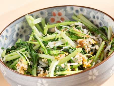 potherb: Japanese cuisine, fried potherb mustard leaf and egg in the bowl Stock Photo