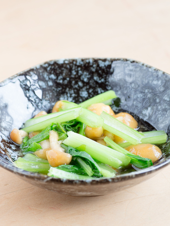 Japanese cuisine, slimy mushroom called nameko and spinach in the bowl Stock Photo