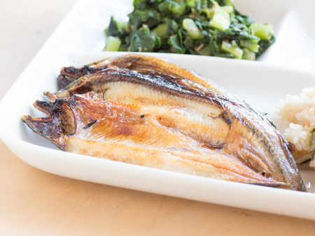 Japanese cuisine, grilled sweetfish on the dish Stock Photo